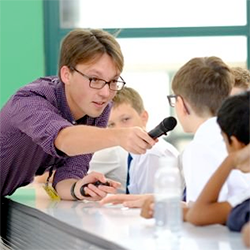 Adam Townsend talk interacting with student